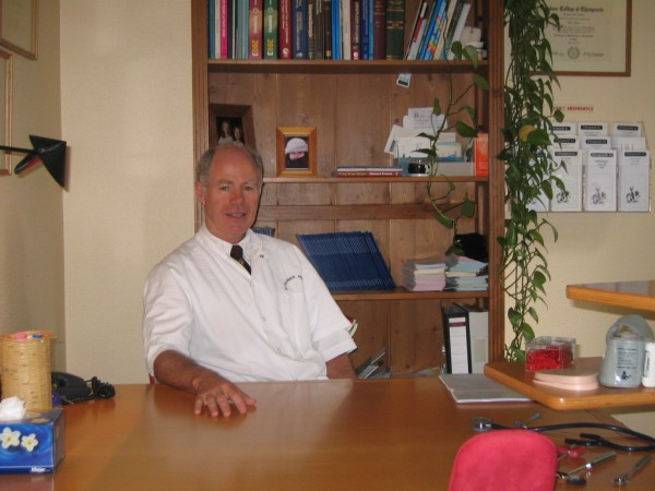 Dr Barrie Lewis at his desk in the Netherlands.