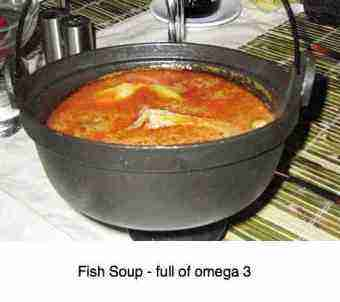 A kettle filled with fish soup.
