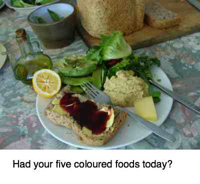A salad with five coloured foods.