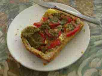 A pesto and tomato sandwich.