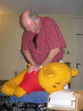 A demonstration showing Teddy being adjusted.