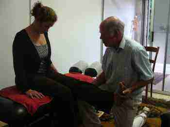 Do you have pain when sitting and someone straightens your leg? With your head flexed on your chest?