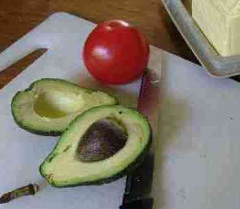 Avocado halves and tomato for prostates
