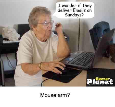 Woman at the laptop likely suffering from mouse arm.